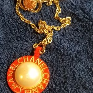 Authentic Chanel pendant with matching earrings